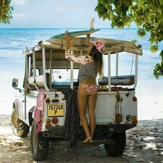 // the car - what else! Land Rover Defender and woman