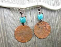 Copper round flat hammered charms, teal puffed rectangle stone. Earrings are not heavy but medium weight about 3 inches long. I want each purchase to be a pleasant experience and for you to be a happy