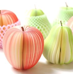 """These adorable fruit-shaped notepads deliver the power of paper with the charm of nature's harvest. From a distance, the notepads look like realistic apples and pears, but up close it's plain to see that the bounty is really comprised of cut, dyed and sculpted blank pages. The notepad stems are made from real twigs, and they're even packaged like grocery store shipments in paper crates with individual, protective Styrofoam wrapping. These delightful office supplies are named """"kudamemo"""" as a…"""