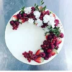 Style- fruit and flowers on very white cake