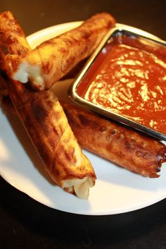 Baked Mozzarella Sticks Ingredients: 12 Wonton or Egg-Roll Wraps, at room temperature 12 Light or Fat-free Mozzarella String Cheese Marinara Sauce (Low-Sodium) for Dipping Small bowl with water, optional
