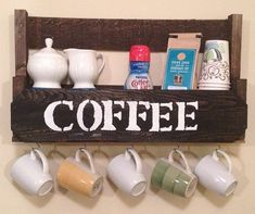 Coffee shelf with cup/mug holders made out of reclaimed wood. These are currently available in Aqua, Burnt Orange, Pecan, Ebony and Natural. The