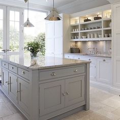 Designed by the talented Tom Howley. French pattern travertine floors, custom shaker cabinetry and marble benchtops.