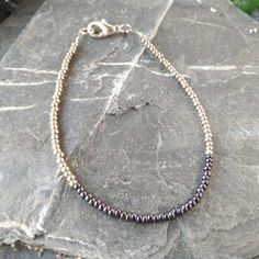 Hey, I found this really awesome Etsy listing at https://www.etsy.com/uk/listing/384434088/silver-and-grey-seed-bead-bracelet-seed