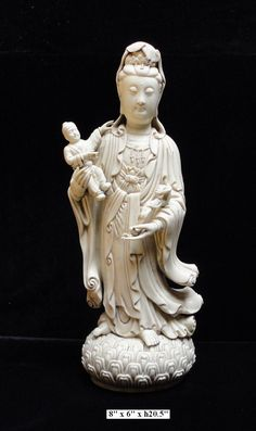 """You are looking at a white porcelain Song Zi Kwan Yin with a boy statue. """"Song Zi"""" means bringing babies. The idea of family heritage is one of the most important common values in the Chinese culture."""