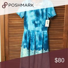 Gorgeous tie dye small lularoe Amelia BNWT. This hard to find Amelia is gorgeous and is dying to be worn this summer! LuLaRoe Dresses Midi