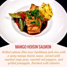 MANGO HOISON SALMON -- Grilled salmon filet over Caribbean jerk rice with a spicy mango sauce; served with sautéed snap peas, roasted red peppers, and grilled pineapple, finished with cilantro.