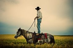 It isn't easy to get your horse to stand still while you stand on their back and survey your land