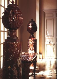"""The hallway of the century Paris town house on Rue de Grenelle features Louis XV Porphyry vases on marble pedestals. image from """"Le Style Givenchy"""" Decoration, Art Decor, Home Decor, Chateau Hotel, Paris Home, World Of Interiors, Interior Decorating, Interior Design, Paris Apartments"""