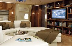 The lounge of this Boeing 747 features wood and leather.