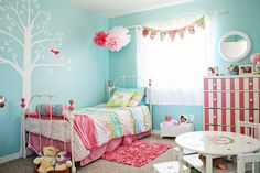 delightful room - name bunting in front of sheer white curtain, wall tree decal, tissue paper pompoms