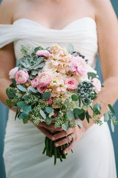 romantic rose, ranunculus and hydrangea bouquet with succulents and seeded eucalyptus by Bella Flora