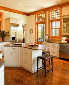 ... | Oak Floors and Trim with White Cabinets and Grayish Counter Tops