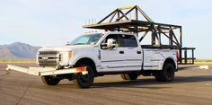 2017 Ford F350 Super Duty, aluminum body, Roll Control Test Rig, http://www.truckcampermagazine.com/news/ford-tests-2017-super-duty-truck-campers/