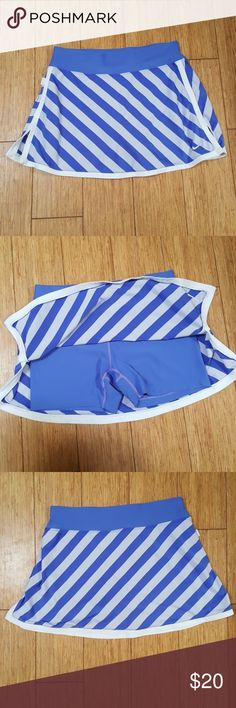 Nike dry fit skirt/skort Like new, no signs of wear. Blue and white Nike skirt with built in shorts. Slight shimmer to the fabric. Super soft. Nike Skirts