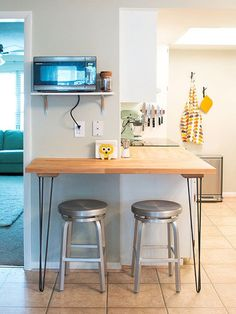 See how this homeowner makes an unconventional kitchen layout work!