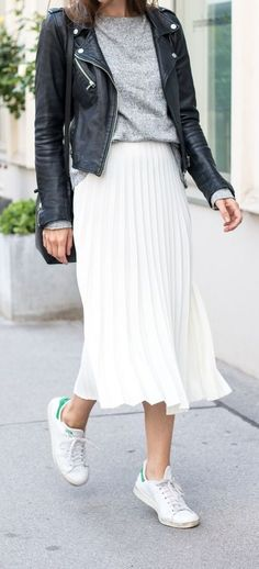 pleated skirt. leather jacket. sneakers.