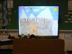 Mrs. T's First Grade Class - love the idea of using the document camera with the smartboard to project their own backgrounds for puppet plays/reader's theatre.