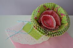Shimmer's bake shoppe party... bakery bag envelopes with cupcake liner flowers.