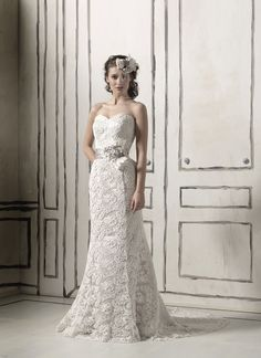 Justin Alexander wedding dresses style 8558 Venice lace mermaid gown with a sweetheart neckline and a semi cathedral length train, this gown comes with a matching beaded and petal ribbon belt.