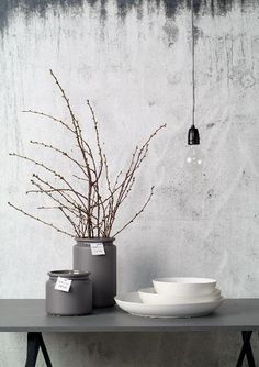 A faded palette, grey styling, grey vases, concrete wall