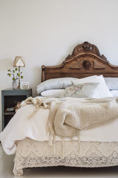 Antique white bedroom with carved wood headboard