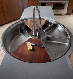The KWC Waterstation is more a multifunctional food prep station than a simple sink. It has wedge-shaped cutting boards, bowls and drainage pans that rotate around an industrial-strength faucet.  Price tag:  $15,000!!!