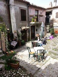Famous little restaurant of Calcata known as Latteria del gatto where years ago was dedicated to the selling of milk and cheese Medieval Town, Most Beautiful, Italy, Restaurant, Outdoor Decor, Tables, Milk, Travel, Cheese