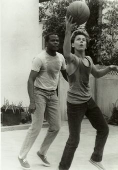 """River Phoenix and Sidney Poitier on the set ofLittle Nikita(1988) """"You're working against raw talent and that's very invigorating for me – he sparkles.""""  Sidney Poitier said about River Phoenix. (Photographer unknown)"""