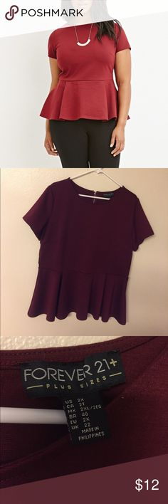 "F21 peplum top Worn once in great condition. Wine colored peplum top. Approx 22"" across bust / approx 27"" length Forever 21 Tops Blouses"