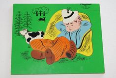 We had this wood puzzle in a set in the early 1970s, I think it was from Playskool. I remember a Winnie the Pooh one, too.