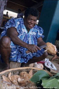 selling coconuts at the daily open market, Port Vila, Efate Island, Vanuatu.