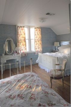 One of the bedrooms at The Prairie by Rachel Ashwell.  Love the rustic look