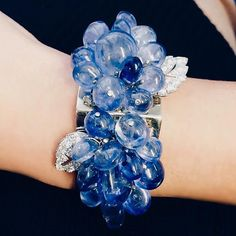Cartier Art Deco creation in our upcoming sale. Sapphire bead and diamond cuff, can also be worn as two dress clips.