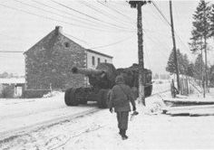 8 inch howitzer section on the move during the Bulge