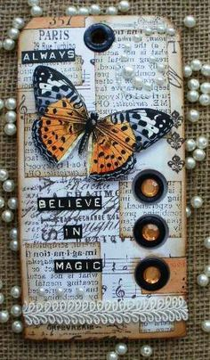 Old paper cream tag, orange gems and butterfly. Quote