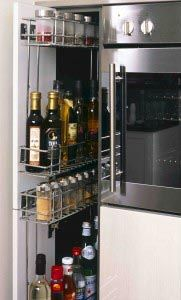 This superb pull out rack provides a great solution for quick access to bottle and spices used frequently in the kitchen. #spicestorage #kitchenstorage