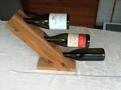 Items similar to 3 bottle wine holder on Etsy Bottle Display, Bottle Rack, Wine Bottle Holders, Wine Bottles, Wood Wine Racks, Wine Glass Rack, Countertop Wine Rack, Beer Bottle Crafts, Wine Gadgets