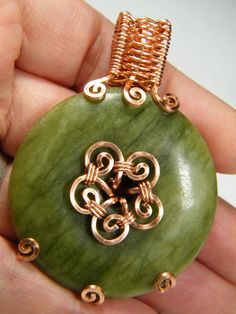 Natural Serpentine donut in copper pendant by NoStoneLeftUnturned