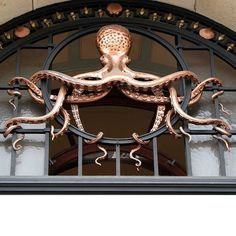From the entryway to the Institut Océanographique in Paris comes what might be the most awesome sculpture to adorn an archway in the history of sculptures and archways. Also Ph'nglui mglw'nafh Cthulhu R'lyeh wgah'nagl fhtagn. Photo by Giacomo Spagnoli (aka VP)