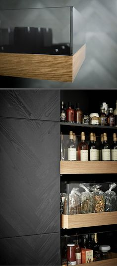 Across the piqu kitchen range we use UV bonding to join glass to various different materials. Here we have bonded glass to wood to create our unique pull out drawers in our Vinculum cabinets - shown in grey ash herringbone veneer.