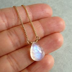 Rainbow Moonstone Necklace with silver chain though Smooth Rainbow by karinagracejewelry