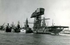 Philadelphia Naval Shipyard circa 1944. The mighty League Island Crane is shown alongside USS Princeton (CV-37) nearing completion, USS South Dakota (BB-57) and USS Wilkes-Barre (CL-103), Dat Dakota