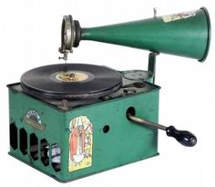 A Genola Tin Toy Phonograph, by the General Phonograph Mfg. Co., Elyria, Ohio. ca. 1930. Painted tin with decals.