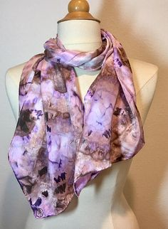 Soft lilacs and vintage browns melt together in this beautiful shibori style handpainted scarf. The colors have a natural, washed look and will compliment any skin tone and add instant elegance to your outfit. The crepe de chine has a very pretty sheen and is light enough to float in the breeze. Measures 11x58 Want to see more scarves from Muse? http://www.etsy.com/shop/MuseSilkPaintings Care Instructions: Hand wash separately in cool water with a tea spoon of mild soap...