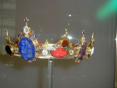 The Devonshire Intaglio Parure was commissioned by the 6th Duke of Devonshire for Countess Granville, the wife of his nephew, to wear in Moscow at the coronation of Tsar Alexander II in 1856. It consists of seven pieces of jewellery (including a bracelet, bandeau, comb, coronet, stomacher, necklace and diadem), all of which are set with a major part of the 2nd Duke of Devonshire's collection of eighty-eight cameos and intaglios.