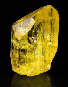 Yellow Scapolite Crystal from Tanzania! i love Scapolite :) A stunning crystal of gemmy Scapolite with shallow, pyramidal termination. It's a sharp crystal in a deep yellow color, highly lustrous, typical for the locality. The crystals come from small outcrops in marble lenses mined by locals. This is an exceptional specimen from this highly regarded, though somewhat mysterious locality.origin: Morogoro marble occurrence, Uluguru Mts (Uruguru Mts), Morogoro Region, Tanzania