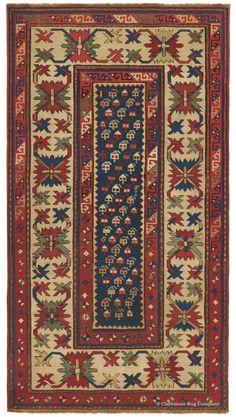 Antique Caucasian Rug with Iconic Designs