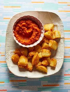 Transport yourself to Spain with Brindisa's patatas bravas recipe. Fried potatoes with spicy tomato sauce, what's not to love?