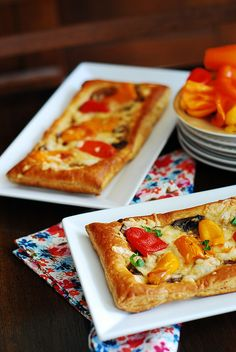 Puff pastry pizza with bell peppers, mushrooms, and Mozzarella cheese.